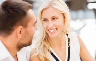 love, people, communication and relations concept - happy couple faces at restaurant looking at each other