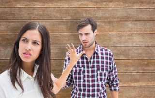 Angry brunette not listening to her boyfriend against wooden planks background