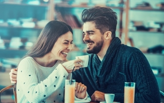 Beautiful couple having coffee on a date.Two people in cafe enjoying the time spending with each other.