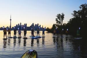 Paddleboarding at dusk in Toronto