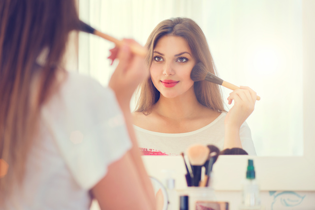 woman looks confident staring in the mirror