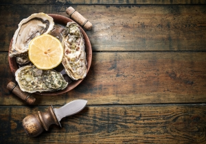 Raw oysters on the old wooden table.