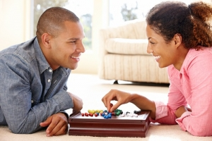 christmas gift guide, board game playing couple