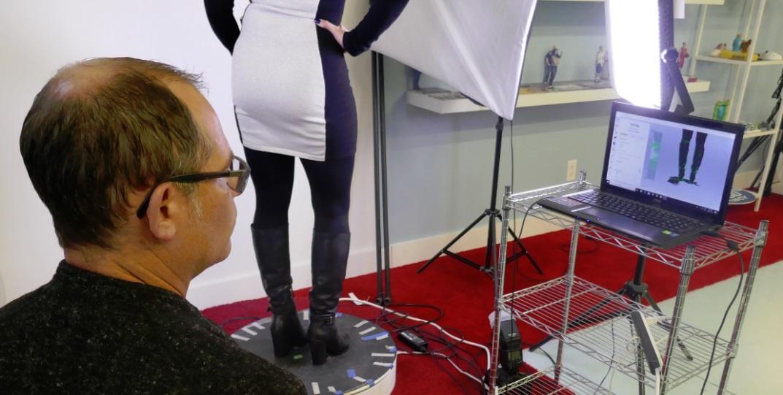 Michael Gossack scans Laura Bilotta's boots