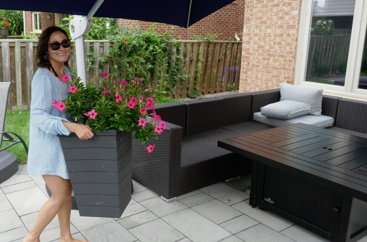 Laura carries flowers into the frame - RIVA outdoor lounge set
