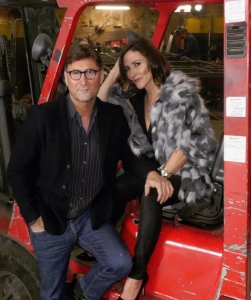 Laura poses on Forklift