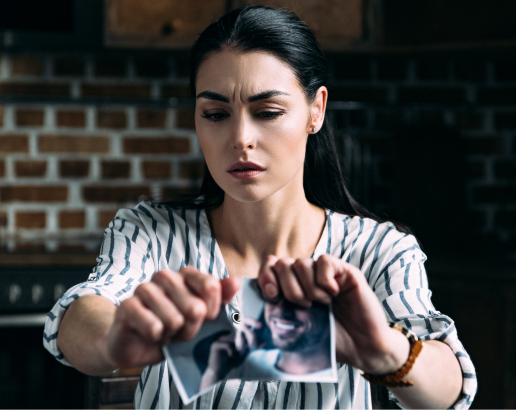 relationship comparison - girl ripping up photo of ex boyfriend